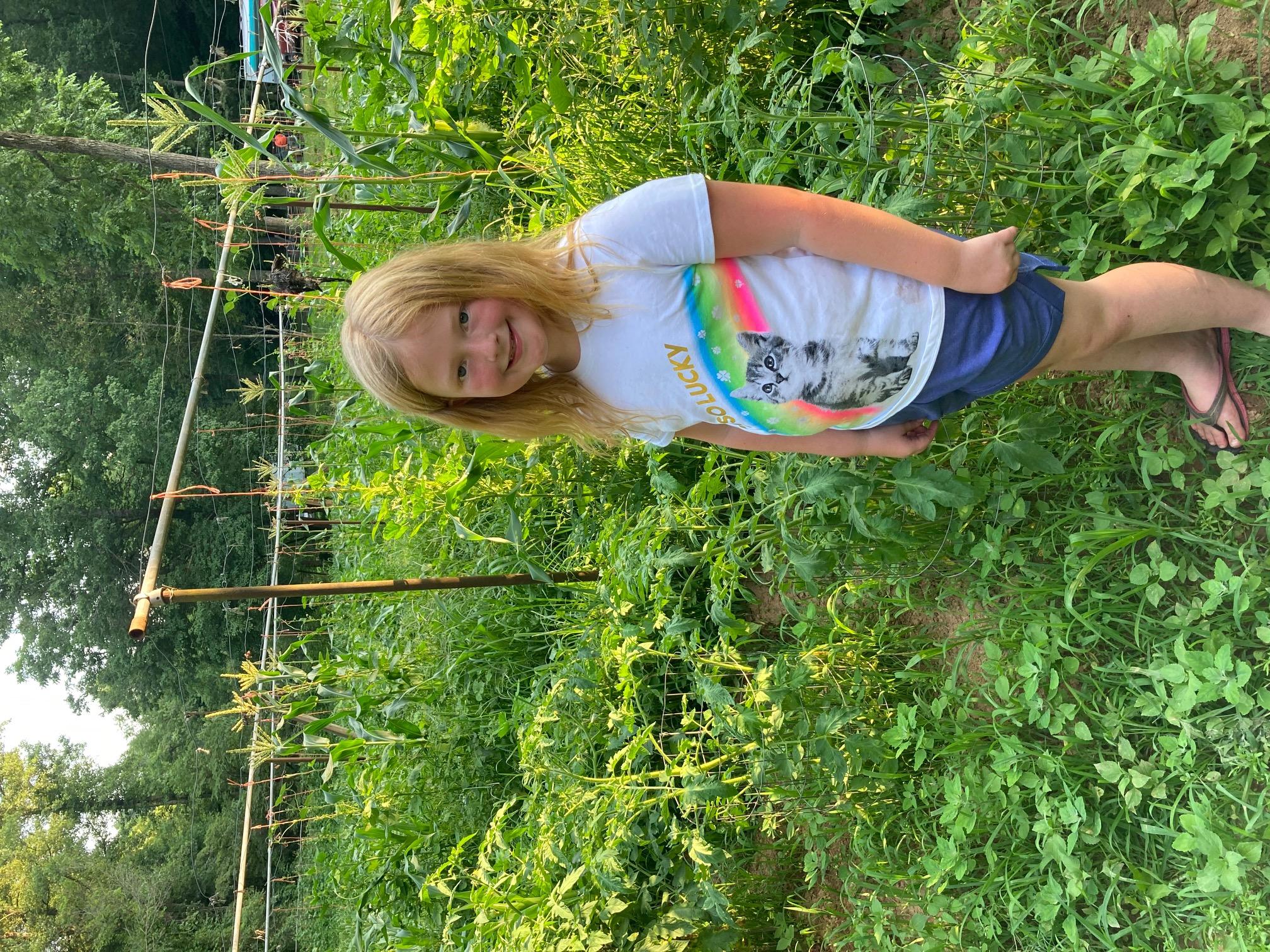 4-Her in her garden